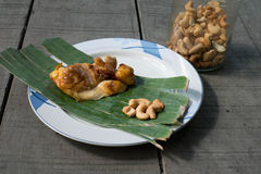 Chick grilled and cashews in dish Royalty Free Stock Photos