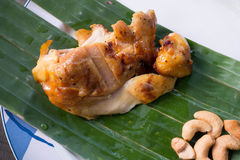 Chick grilled and cashews in dish Stock Photo