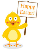 Chick Holding Happy Easter Sign sveglio Fotografie Stock
