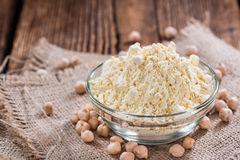 Chick Pea Flour on dark rustic background Royalty Free Stock Photo