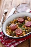 Chick pea with fried smoked sausages Stock Photos