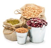 Chick-pea, mung beans, kidney-beans in the sacks isolated on whi Stock Images