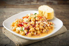 Chick pea salad. Tasty chick pea salad with feta cheese, red onions and herbs Royalty Free Stock Photography