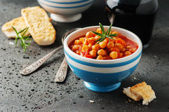 Chick-pea with tomato, carrot and rosemary. Selective focus Royalty Free Stock Photography