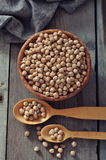 Chick-pea in wooden bowl Stock Image