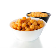Chick peas. White and black bowls of cooked chick peas Stock Photo