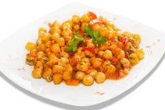 Chick Peas mit Tomaten Stockfotos