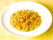 Chick peas soup. Delicious chick pea soup on dining table Royalty Free Stock Image