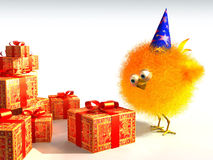 Chick's birthday. A happy chick looking at the presents Stock Image
