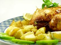 Chicken. Roast chicken whit potatoe and salad Royalty Free Stock Images
