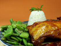 Chicken. Whit tomato sauce and cooked ric. Served whit green beans Royalty Free Stock Photos