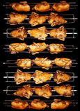 Chicken. Tasty grilled chicken turn golden brown on the spit Stock Image