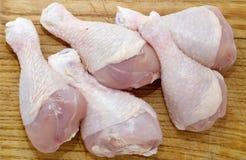 Chicken. Raw chicken on wooden board Stock Photos