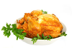 Chicken. Cooked chicken on plate on white background Stock Photo