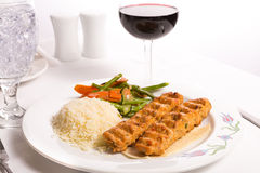 Chicken Adana Kebap Served with Rice Pilaf Vegetables and Red Vi Royalty Free Stock Photography