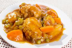 Chicken afritada on plate Royalty Free Stock Images