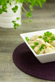 Chicken Aldredo garnished with flat leaf parsley, vertical Stock Images