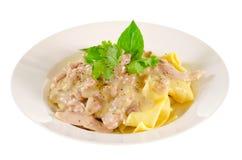 Chicken Alfredo Pasta. A dish of chicken alfredo pasta, isolated on white Stock Image