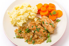 Chicken in almond sauce dinner high angle Royalty Free Stock Photos