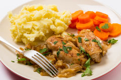 Chicken in almond sauce with fork Royalty Free Stock Image