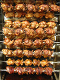 Chicken anyone?. Lots of chicken and more on a big grill. could be a symbol for abundance, affluence, wealth, prosperity etc Royalty Free Stock Photo