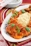 Chicken and apricot tajine served over couscous Stock Photos