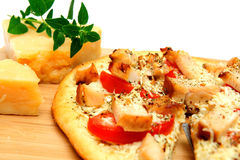 Chicken And Asiago Cheese Pizza. Grilled chicken, fresh tomatoes, garlic and grated Asiago cheese top this gournet pizza for one topped off with dried herbs and Stock Photos