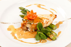 Chicken with asparagus Stock Images
