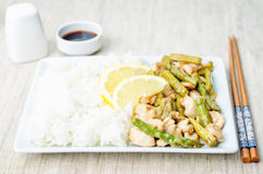 Chicken asparagus lemon stir fry Stock Images