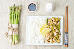 Chicken asparagus lemon stir fry Stock Photography