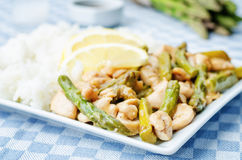 Chicken asparagus lemon stir fry Stock Photos
