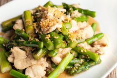 Chicken and Asparagus Stir Fry. Freshly prepared Asian style chicken and asparagus stir fry with garlic Royalty Free Stock Images
