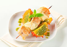 Chicken and aubergine skewer with pesto and horned melon Royalty Free Stock Image