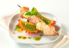Chicken and aubergine skewer with pesto and horned melon Royalty Free Stock Photography