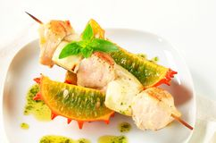 Chicken and aubergine skewer with pesto and horned melon Stock Image