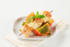 Chicken and aubergine skewer with pesto and horned melon Stock Images