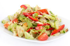 Chicken and avocado fresh salad over white Royalty Free Stock Images