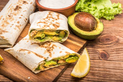 Chicken, avocado and vegetables burrito. Stock Image