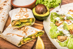 Chicken, avocado and vegetables burrito. Royalty Free Stock Photography
