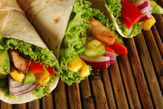 Chicken and avocado wrap sandwiches on mat Royalty Free Stock Photo