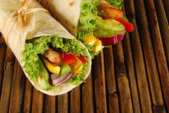 Chicken and avocado wrap sandwiches on mat Royalty Free Stock Photography