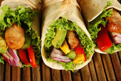 Chicken and avocado wrap sandwiches on mat Royalty Free Stock Photos