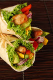 Chicken and avocado wrap sandwiches on mat Stock Image