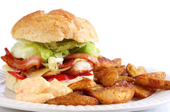 Chicken and Bacon Burger and Wedges Stock Images