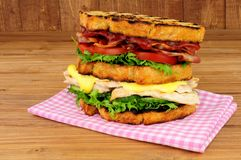 Chicken And Bacon Double Decker Sandwich. On a wood background Royalty Free Stock Photos