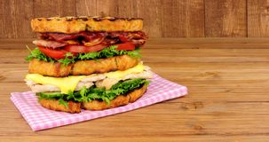 Chicken And Bacon Double Decker Sandwich. On a wood background Stock Image