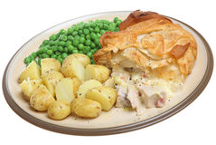 Chicken & Bacon Pie with Filo Pastry. Chicken and bacon pie with filo pastry top served with new potatoes and garden peas Stock Photography