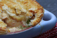 Chicken and bacon pot pie with cheese Stock Images