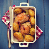 Chicken with bacon and potato in dish with napkin Royalty Free Stock Photography