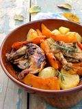 Chicken baked with potato and pumpkin Stock Photos